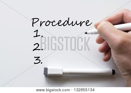 Human hand writing procedure on whiteboard .
