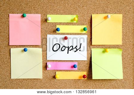 Colorful sticky notes on cork board background