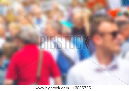 Crowded street as blur background unrecognizable everyday ordinary people commuting