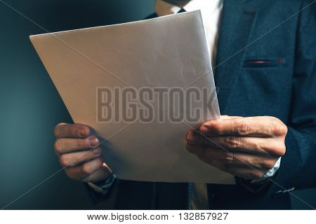 Lawyer reading legal contract agreement person in elegant business suit examining document.