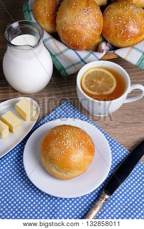 Bun with sesame seeds with slices of butter milk tea for breakfast