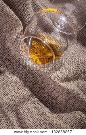 Glass Of Brandy Overturned