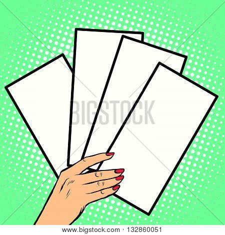 Booklets or tickets in hand pop art retro vector. Business concept pure white forms