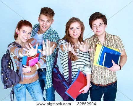 Happy group of students holding notebooks , isolated on white background.