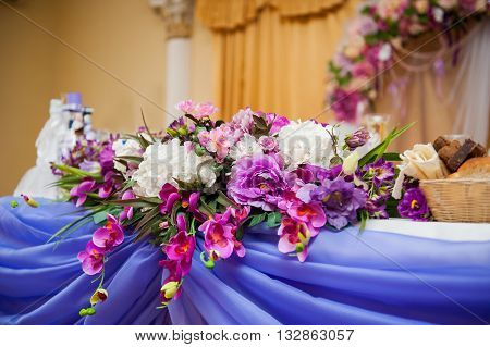 decor of flowers on a table bride and groom. Beautiful wedding restaurant for marriage.