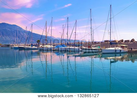 sunset boats reflection at Kalamata harbor Peloponnese Greece