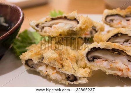 Close up shiitake with shrimp tempura on plate