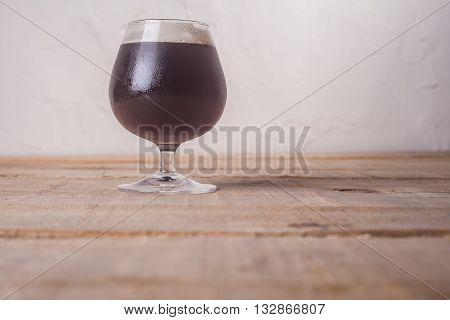 Dark Beer On Wood