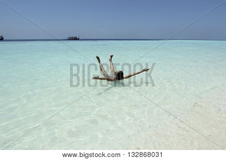 woman in turquise water  in maldives beach