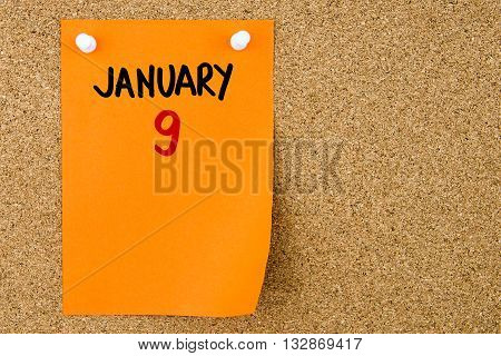 9 January Written On Orange Paper Note