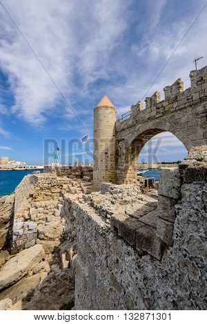 Rhodes island, Greece - May 20, 2016: Fortifications and harbour of Rhodes town in May 20, 2016, Rhodes island, Dodecanese, Greece.