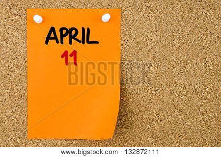 11 April Written On Orange Paper Note