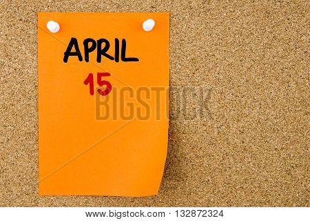 15 April Written On Orange Paper Note