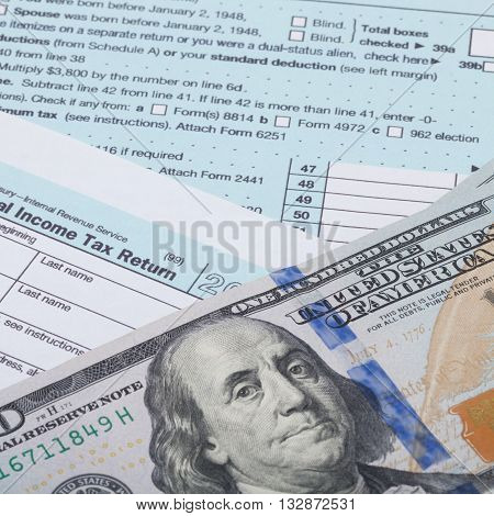 Us 1040 Tax Form And Dollars - Studio Shot