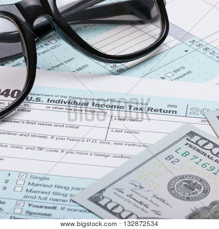 Us 1040 Tax Form, Glasses And Dollars - Studio Shot