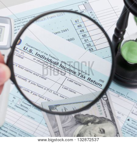 Usa 1040 Tax Form With Magnifying Glass And Hourglass