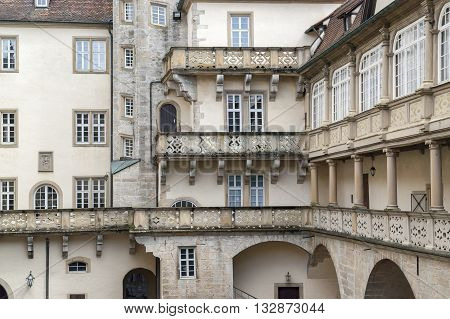 a historic courtyard with balcony and balustrade