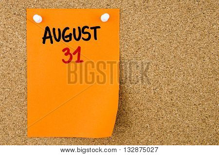 31 August Written On Orange Paper Note