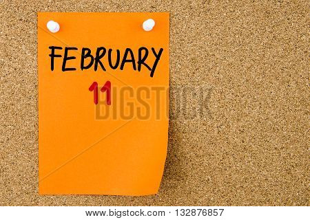 11 February Written On Orange Paper Note