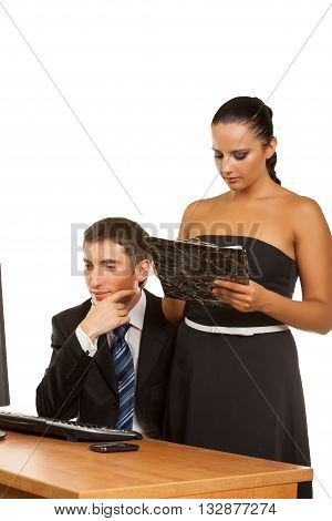 Two contemporary businesspeople discussing while working at the computer Isolated on white background