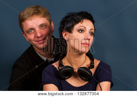 boy and girl on a dark background. young couple in love