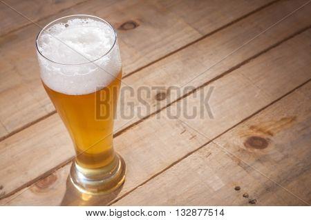Big Glass Of Beer On Wood