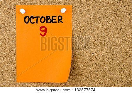 9 October Written On Orange Paper Note