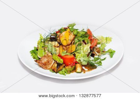 Salad with aubergine and meat on white background
