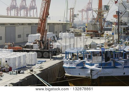 Salalah,Oman - October 24, 2014:Large harbour crane loading cargo on a vessel at the Port of Salalah