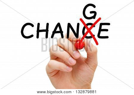 Hand turning the word Chance into Change with red marker isolated on white.