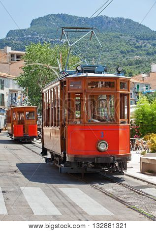 PORT DE SOLLER, MAJORCA - JULY 12, 2012: Vintage tram in a street of Port de Soller. Majorca