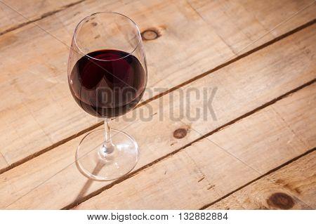 Glass Of Wine On Wood
