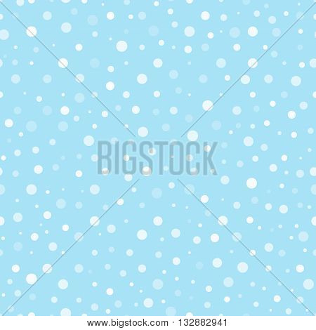 Seamless pattern with round snowflakes varying transparency on blue background