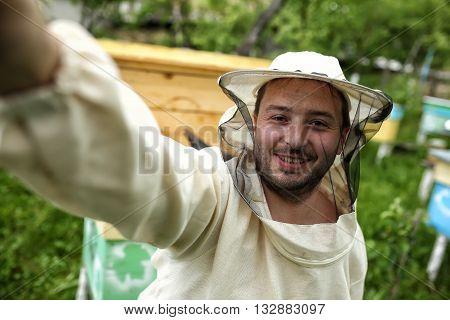 beekeeper makes selfie in the apiary, beekeeping