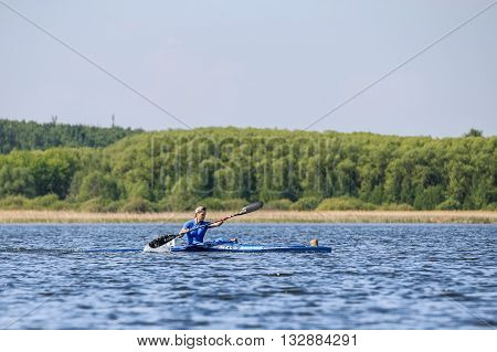 Chelyabinsk Russia - May 28 2016: young man athlete on rowing kayak on lake during Ural championship in rowing