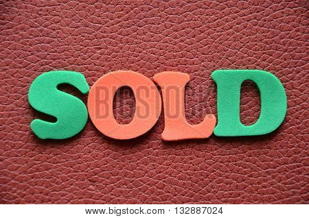 WORD SOLD ON A   ABSTRACT  COLORFUL BACKGROUND
