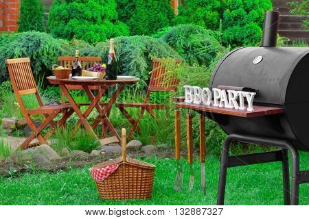 Barbecue Grill Appliance With Tools And Bbq Party Sign