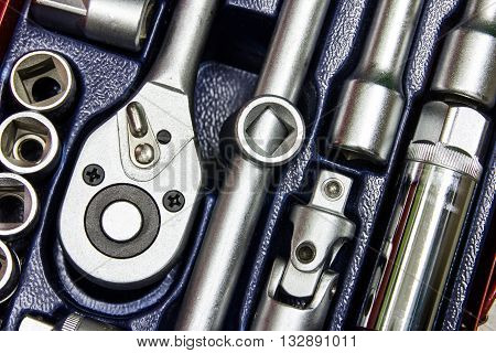 Close up of car engine with tools