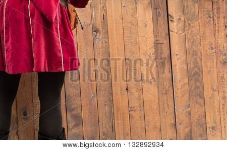 medieval costume on background with wooden slats.