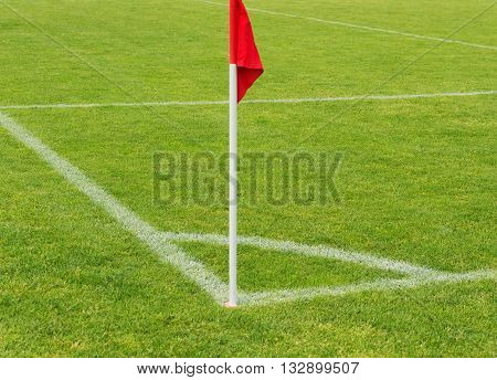 Corner flag on an soccer field during a football mach