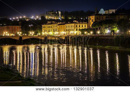 Ponte Vecchio and Arno river in Florence. Historical view of Italy at night