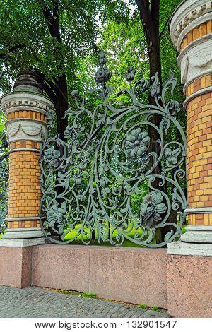 Art metal fence of the Mikhailovsky Garden in Saint Petersburg. Russia