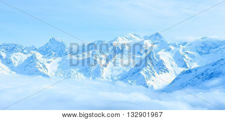Beautiful Winter Landscape Of Caucasus Mountains With Clouds And Blue Sky, Close Up