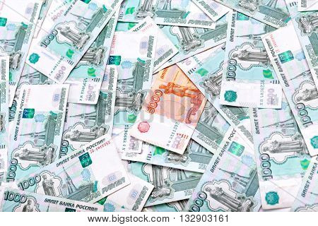 Money and Russian banknotes of one and five thousand in the background