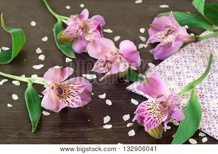 Alstroemeria flowers (Peruvian lily or Lily of the Incas) on wooden background