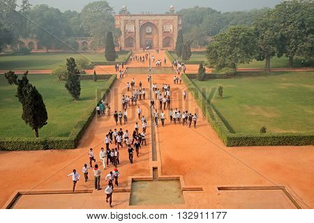 DELHI, INDIA - NOVEMBER 23, 2015: Visitors at the entrance to the historical Humayuns tomb and garden - a UNESCO world heritage site