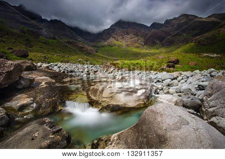 Coruisk River among cloudy Black Cuillins mountains Isle of Skye Scotland