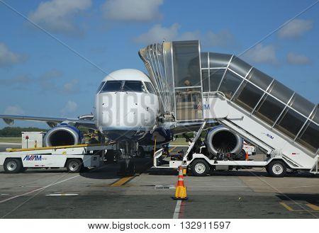 PUNTA CANA, DOMINICAN REPUBLIC - JANUARY 4, 2016: Passenger jet on tarmac at Punta Cana International Airport