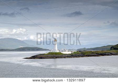 Lighthouse on Eilean Musdile near Oban in daylight Scotland