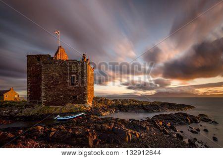 Portencross Scottish castle on coastline in susnset light